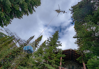 Annual helicopter deliver day for 30000lb of nonperishable supplies for the tea house main summer season.
