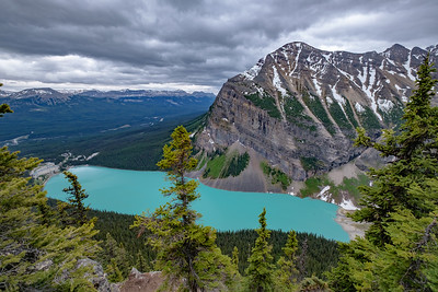 View down into Lake Louise with canoeists, from on top of the Big Bee Hive on the Devil's Thumb.