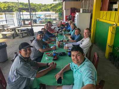 Group photo at a restaurant along the Rio Sierpe - Costa Rica.  Guides Dennis and Diego at front; photographer Steve Perry second from left.