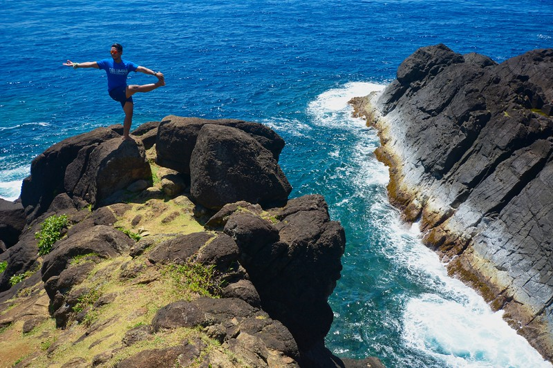 Yoga asana by the rocks