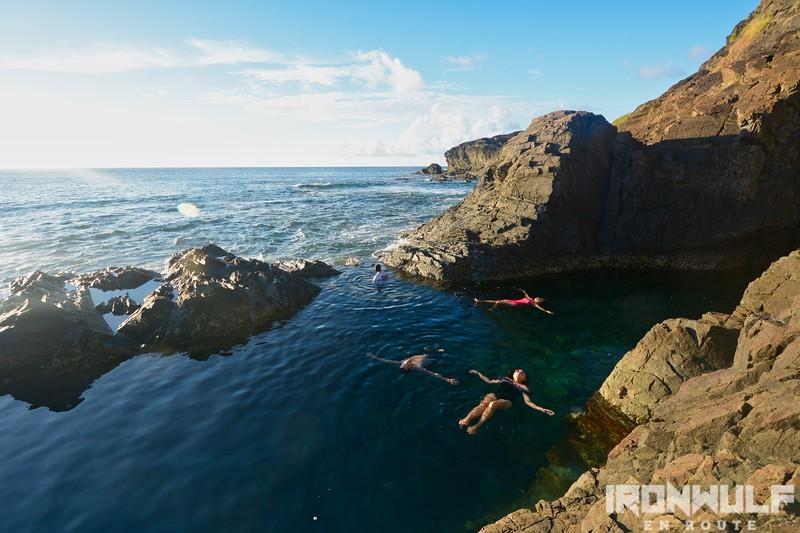 Floating at the rock-sheltered Tuwad-Tuwadan Blue Lagoon