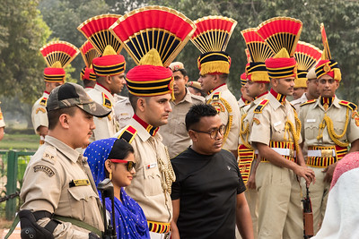 People take snapshots with police in dress uniform, near the India Gate in Delhi.