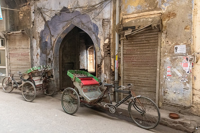 Bicycle rickshaws and an interesting old gate in Old Delhi.