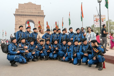 The Delhi SWAT team is photographed (and photobombed) in front of the India Gate, in Delhi.