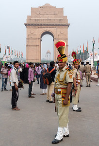 Police in dress uniform assemble near the India Gate in Delhi.