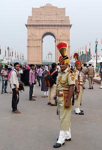 Police in dress uniform assemble near the India Gate in Delhi.