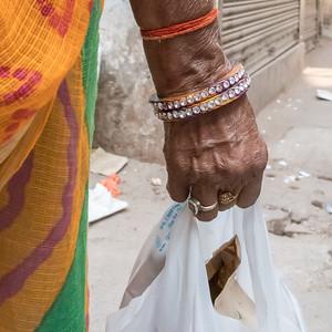 An elderly shopper on the streets of Old Delhi.