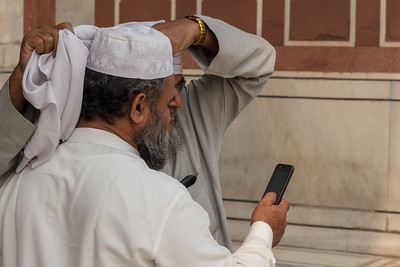 Two men share a selfie after prayer at Jama Masjid mosque, in Delhi.