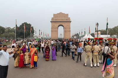 People (and police in dress uniforms) at an event near India Gate, Delhi.