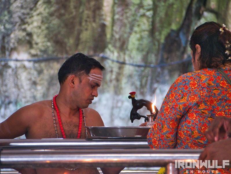 A Hindu priests attending to devotees