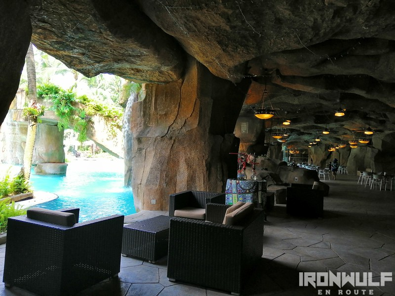 Cave-like lounge area behind the pool falls
