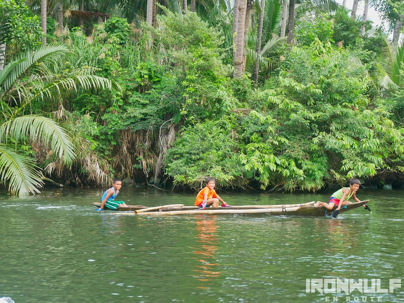 Kids playfully paddling a raft at Kadak-an River