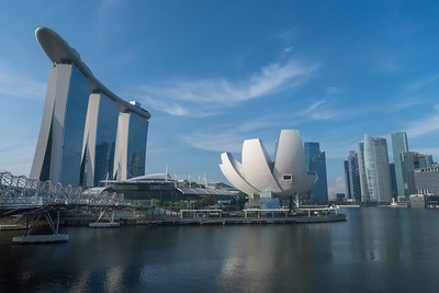 Marina Bay, Singapore, with the helix bridge (left), Marina Bay Sands hotel (center), and lotus-shaped museum (right).  Financial district at far right.