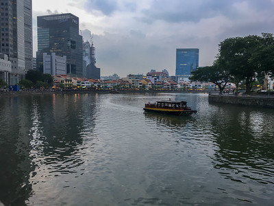 Tour boat on the river, with Boat Quay to the center back.