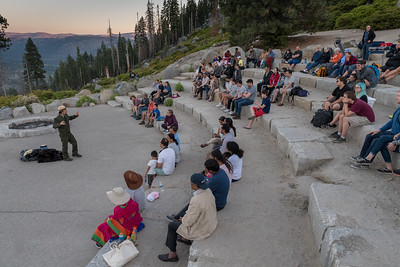 Kids listen to the ranger's talk in the amphitheatre at Glacier Point, Yosemite National Park.