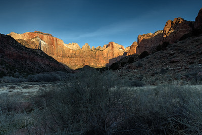Towers of the Virgin, at sunrise, from behind Human History museum; Zion National Park.
