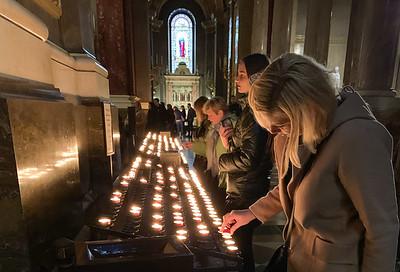 A visitor lights candles at Szent Iztván Basilika - Budapest.