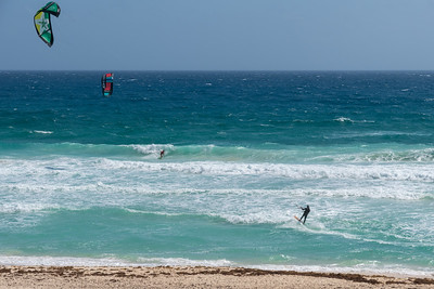 Kite-surfers on the beach in Cancun.