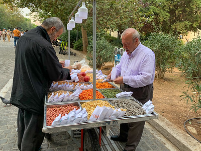 Vendors of nuts and dried fruits on Dionysis street,  Athens.