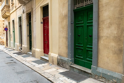 A colorful row of doors in Valleta, Malta.