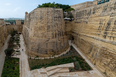 Rampila Restaurant nestles at top right, above the dry moat around the city of Valleta, Malta.