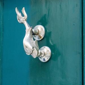 Door knockers are often whimsical in Valleta, Malta.