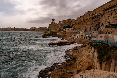 Waves splash a little fishing niche in the harbor of Valleta, Malta.