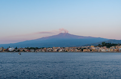 Mount Etna at sunrise, from offshore of Naxos, Sicily.