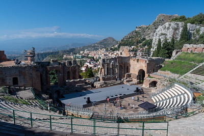 Greco-Roman theater in Taormina, with Mount Etna erupting at rear; Sicily.