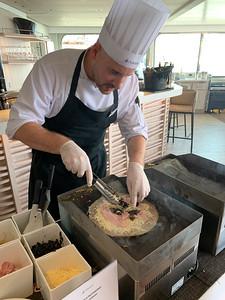 The ship's chef prepares specialty crepes, a la Brittany.