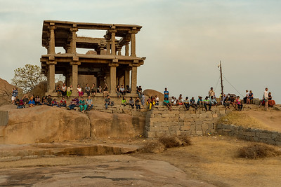 People gather to watch sunset from Hemakuta Hill, Hampi.