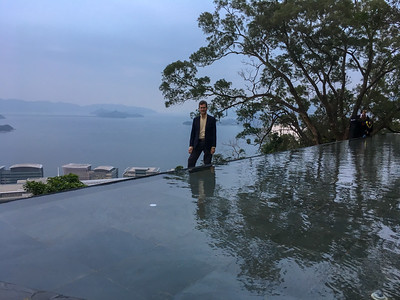 David stands beside an 'infinity' fountain at the top of the CUHK campus, overlooking the harbor.