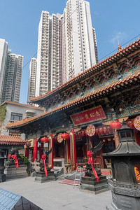 The ancient Wang Tai Sin temple is dwarfed by modern high-rise apartments, in Hong Kong.