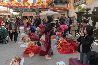 Pilgrims pray for their wishes at Wang Tai Sin temple in Hong Kong.