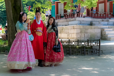 Tourists in costume take selfies at the secret gardens at Changdeokgung Palace in Seoul.