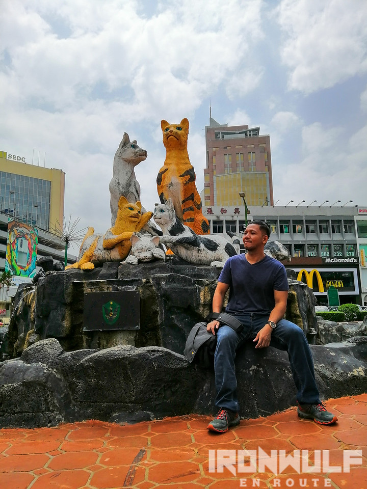 Posing at the North City Hall Family Cat Statue