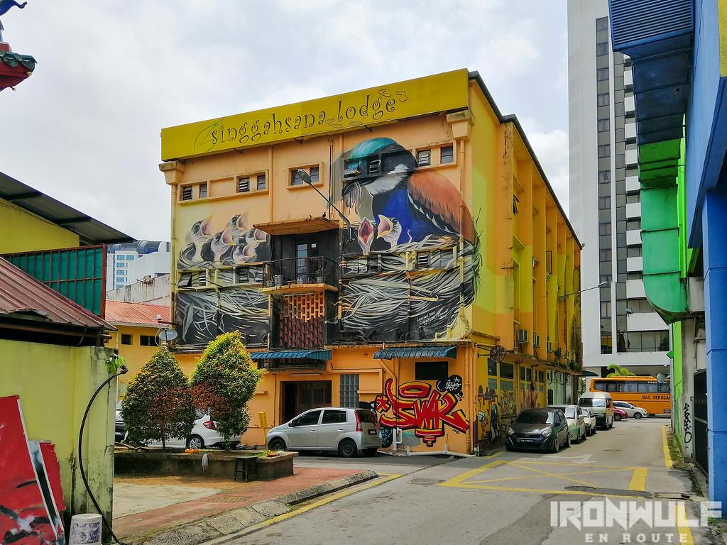 3-story Singgahsana Lodge enwrapped in a a mural