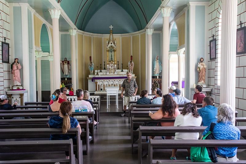 Inside St. Philomena Church, Kalawao. Richard Miller (guide, historian, pastor)  in front