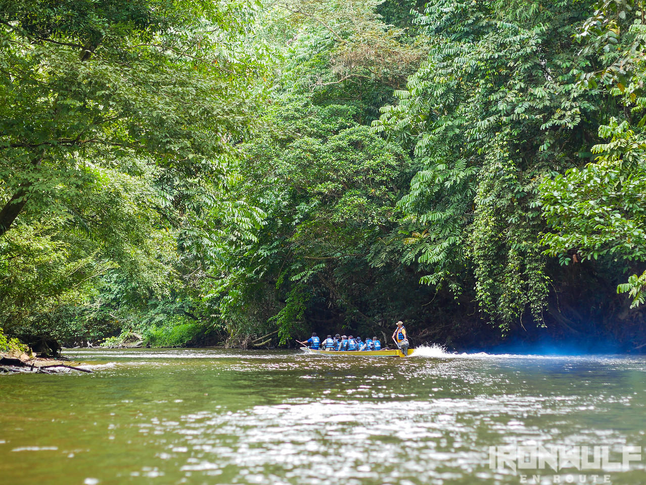 A group of tourists on a longboat at Melinau river