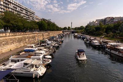 Canal Saint-Martin, with the Bastille at rear. Paris.