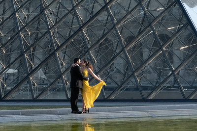 A couple at Le Louvre for an early morning photo shoot.