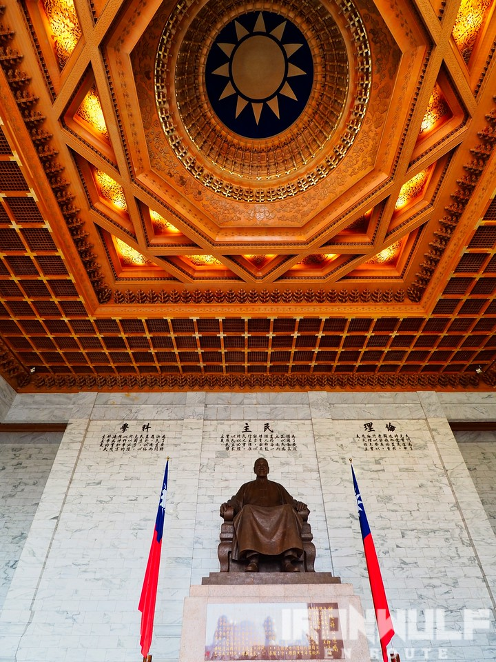 The statue of Chiang Kai-shek at the upper chamber and the KMP symbol at the roof dome