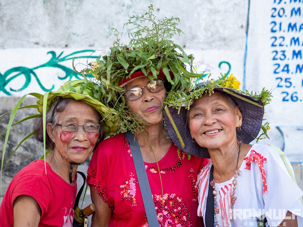 Elder revelers with traditional plant adornments on their heads.