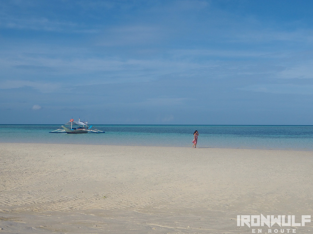 Wide sand and blue waters