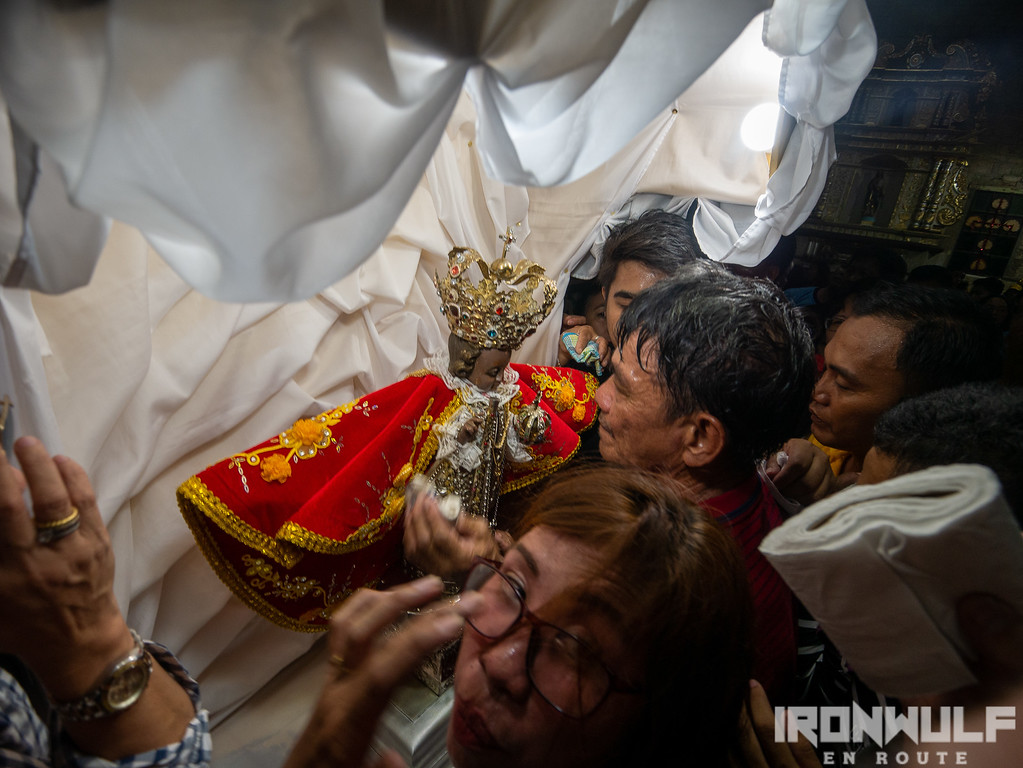Devotees close to the Sto Niño