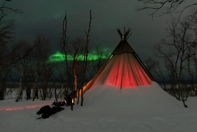 Northern Lights and teepee as seen from Abisko.