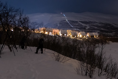 Northern Lights photography tour, close to Abisko STF  cottages and the light of its chair lift.
