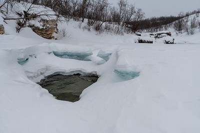 Water, ice, and snow in the upper canyon, Abisko.