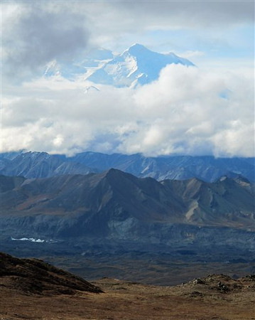 In this Sept. 11, 2011 photo, clouds obscure a portion of Mount McKinley, in De