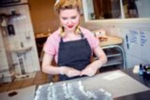 A woman wraps caramels at Parlans, where the workers all dress in swing-era gar